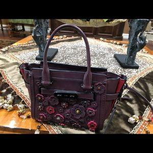 Rarely used Coach embellished crossbody bag